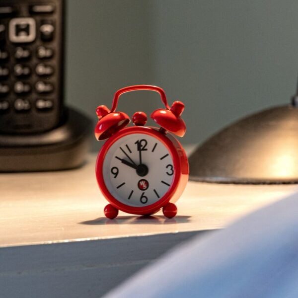 worlds-smallest-alarm-clock-on-bedside-table